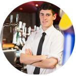 Male bartender profile picture, standing behind a bar