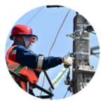 Electrician working on infrastructure electric pole