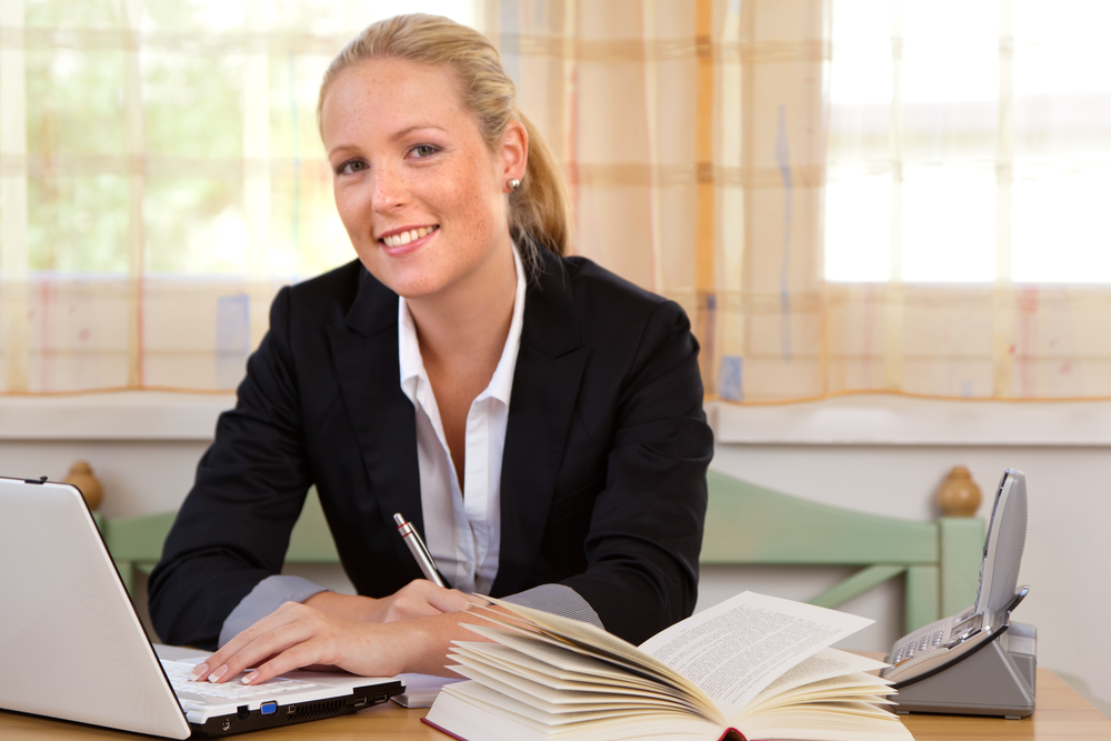 Young female paralegal working at a desk
