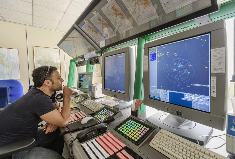 Air traffic controller at work in Italy in control room